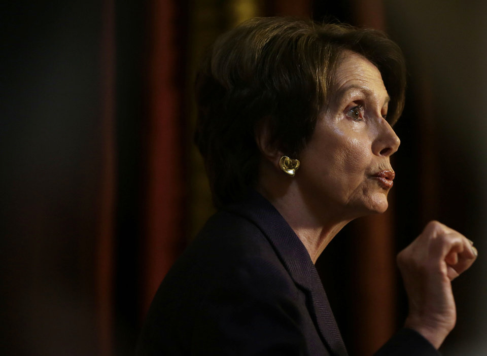 Photo - House Minority Leader Nancy Pelosi of Calif. gestures as she speaks to reporters at Statuary Hall on Capitol Hill in Washington, Friday, Dec. 7, 2012. (AP Photo/Pablo Martinez Monsivais)