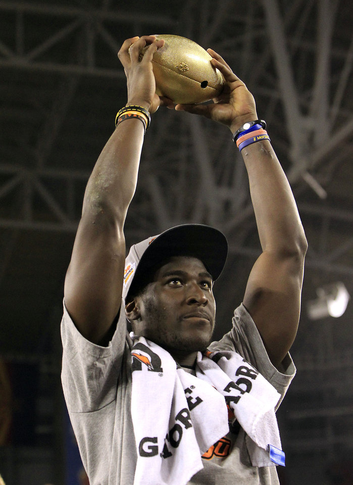Oklahoma State's Justin Blackmon holds the Fiesta Bowl Championship Trophy after the Fiesta Bowl NCAA college football game against Stanford Monday, Jan. 2, 2012, in Glendale, Ariz.  Oklahoma State defeated Stanford 41-38 in overtime.(AP Photo/Ross D. Franklin) ORG XMIT: PNP151