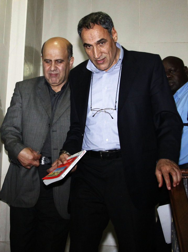 Photo -   FILE - In this Monday, June 25, 2012 file photo, Iranian nationals Ahmad Abolfathi Mohammad, left, and Sayed Mansour Mousavi arrive in court in Nairobi, Kenya, where they faced charges related to the possession of explosives. On Monday, July 2, 2012, officials told The Associated Press that Mousavi and Mohammad, who led authorities to a cache of explosives after their arrest, planned to attack Israeli, U.S., British or Saudi targets inside Kenya. (AP Photo/Khalil Senosi, File)