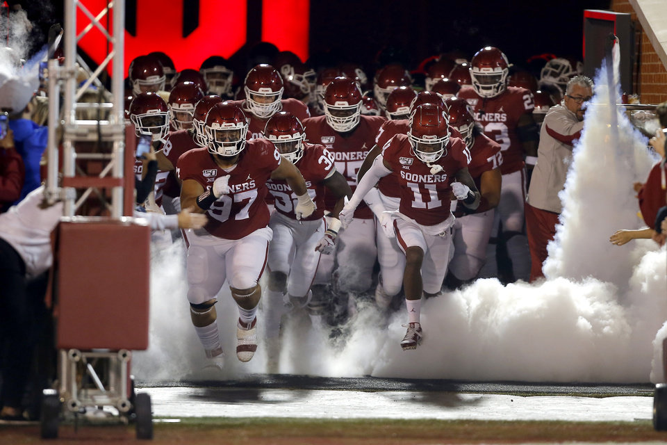 Photo - Oklahoma takes the field before an NCAA football game between the University of Oklahoma Sooners (OU) and the Iowa State University Cyclones at Gaylord Family-Oklahoma Memorial Stadium in Norman, Okla., Saturday, Nov. 9, 2019. [Bryan Terry/The Oklahoman]