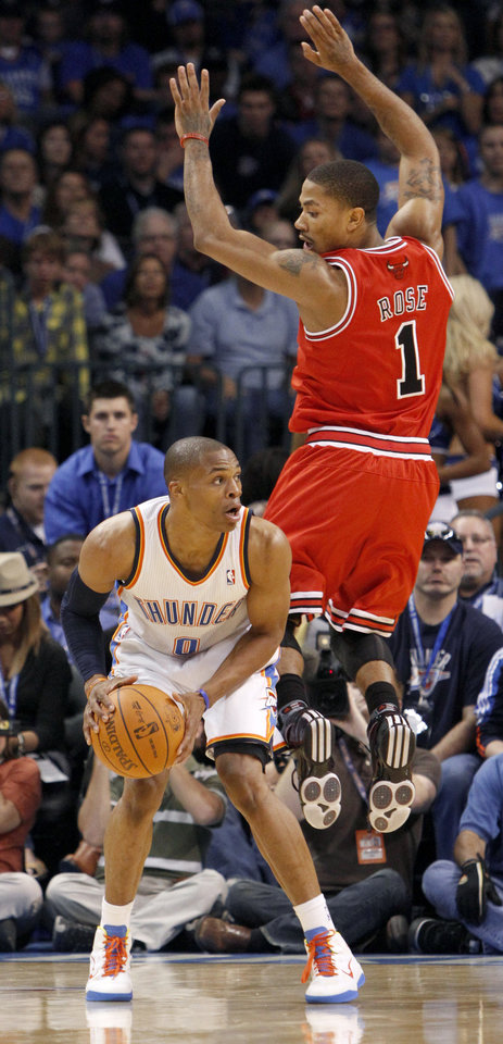 Photo - Oklahoma City's Rusell Westbrook tries to get by Chicago's Derrick Rose during the NBA basketball game between the Oklahoma City Thunder and the Chicago Bulls in the Oklahoma City Arena on Wednesday, Oct. 27, 2010. Photo by Bryan Terry, The Oklahoman