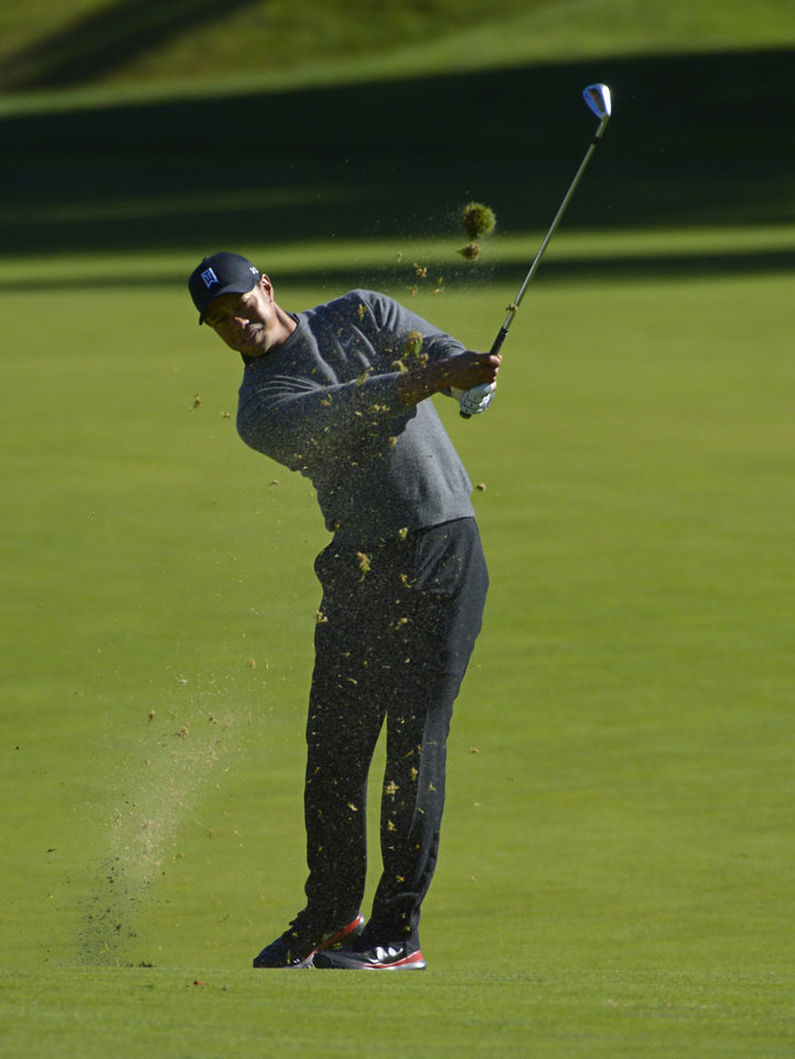 Tiger Woods makes his approach shot on the 11th hole during the pro-am portion of the Northwestern Mutual World Challenge, Wednesday, Dec. 4, 2013, in Thousand Oaks, Calif. (AP Photo/Mark J. Terrill)