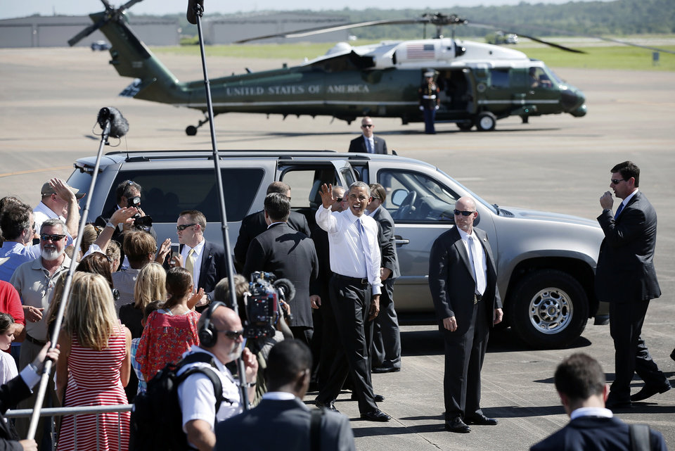 Photo - President Barack Obama waves goodbye to persons in attendance at his arrival the North Texas Regional Airport in Denison, Texas, July 15, 2015. (AP Photo/Tony Gutierrez)