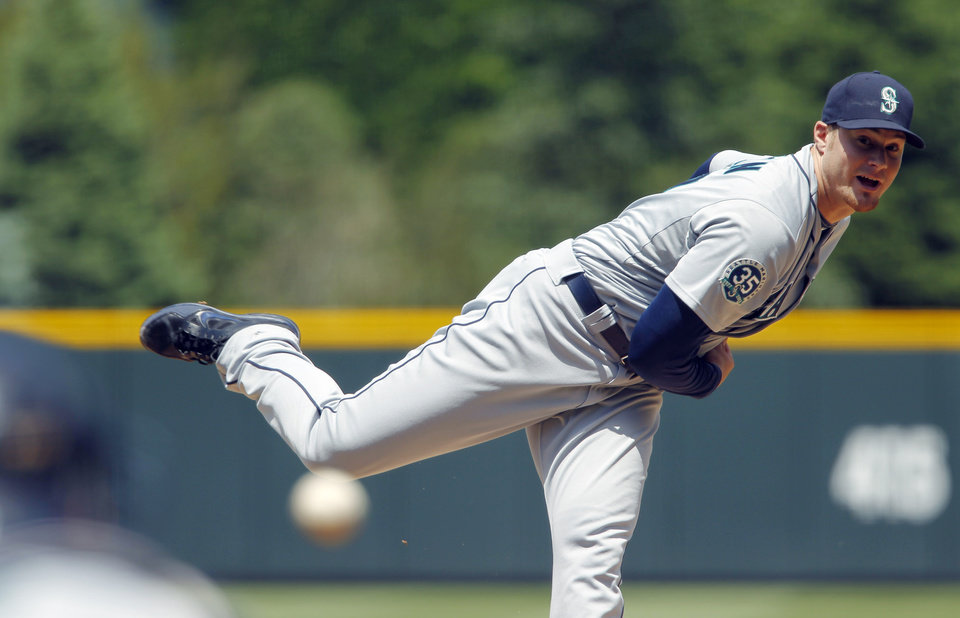 Photo -   Seattle Mariners starting pitcher Blake Beavan delivers to Colorado Rockies' Marco Scutaro in the first inning of an interleague baseball game in Denver on Sunday, May 20, 2012. (AP Photo/David Zalubowski)