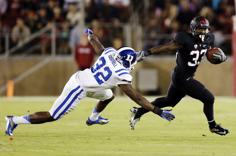 Photo -   Stanford running back Stepfan Taylor, right, runs past Duke safety August Campbell during the first half of an NCAA college football game in Stanford, Calif., Saturday, Sept. 8, 2012. (AP Photo/Marcio Jose Sanchez)