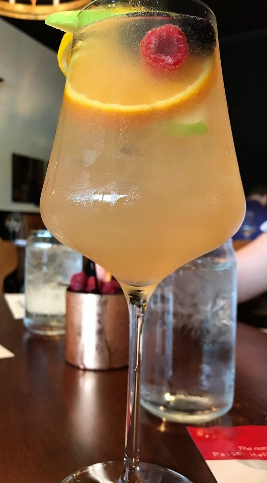 Photo - White Summer Sangria from Sparrow Modern Italian in Edmond. [Dave Cathey/The Oklahoman]