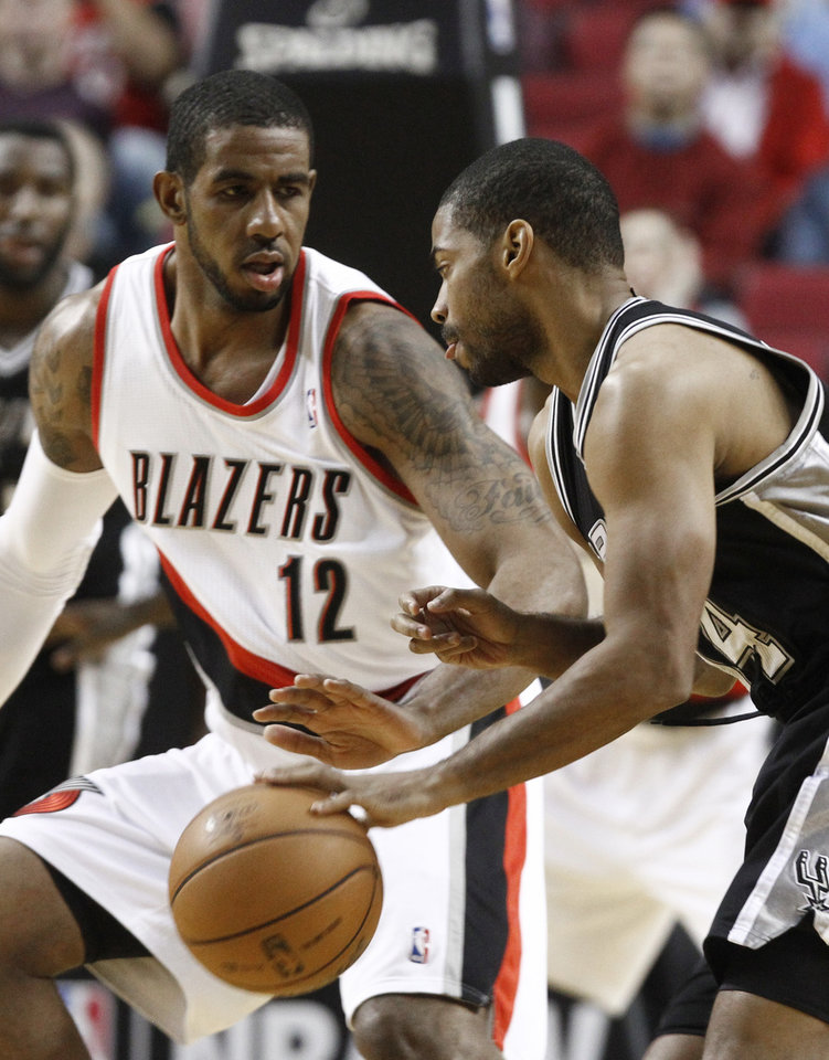 San Antonio Spurs guard Gary Neal, right, drives on Portland Trail Blazers forward LaMarcus Aldridge during the first quarter of an NBA basketball game in Portland, Ore., Thursday, Dec. 13, 2012. (AP Photo/Don Ryan)