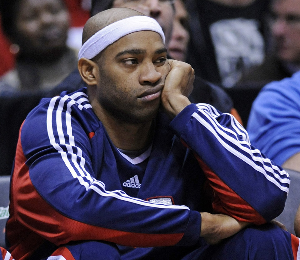 Photo - New Jersey Nets' Vince Carter looks on from the bench during the fourth quarter as the Boston Celtics beat the Nets 105-85 in an NBA basketball game Saturday, Jan. 17, 2009 in East Rutherford, N.J. (AP Photo/Bill Kostroun) ORG XMIT: ERA108