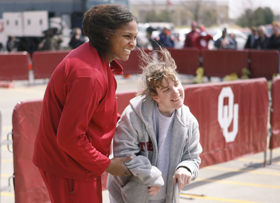 Photo - NCAA TOURNAMENT / OU / SEND OFF: University of Oklahoma women's college basketball player Courtney Paris poses for a photo with fan Tiffany England outside the Lloyd Noble Center in Norman, OK, Thursday, April 2, 2009, as the team prepares to leave for the Women's Final Four. BY PAUL HELLSTERN, THE OKLAHOMAN ORG XMIT: KOD
