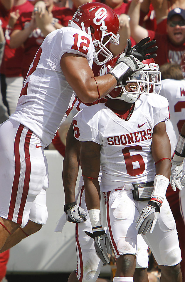 Oklahoma's Travis Lewis (12) celebrates with Demontre Hurst (6) after a touchdown during the Red River Rivalry college football game between the University of Oklahoma Sooners (OU) and the University of Texas Longhorns (UT) at the Cotton Bowl in Dallas, Saturday, Oct. 8, 2011. Photo by Chris Landsberger, The Oklahoman