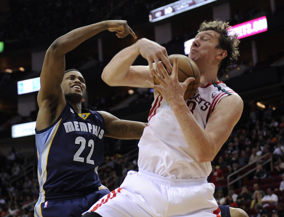Houston Rockets' Omer Asik (3) grabs a rebound in front of Memphis Grizzlies' Rudy Gay (22) in the second half of an NBA basketball game on Saturday, Dec. 22, 2012, in Houston. The Rockets won 121-96. (AP Photo/Pat Sullivan)