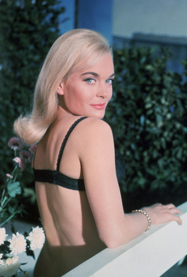"CORRECTS ID AND FILM TITLE - This undated publicity photo provided by United Artists and Danjaq, LLC shows Shirley Eaton from the James Bond 1964 film, ""Goldfinger."" Initially, Bond girls were part of the aesthetic of the series. The film is included in the MGM and 20th Century Fox Home Entertainment Blu-Ray ""Bond 50"" anniversary set. (AP Photo/United Artists and Danjaq, LLC)"