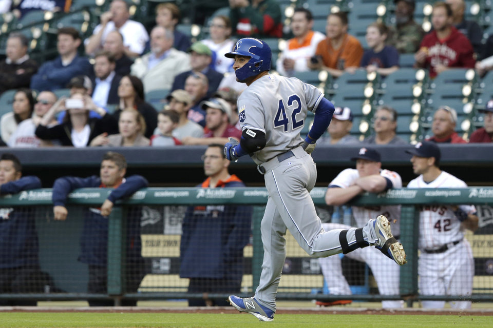 Photo - Kansas City Royals' Omar Infante rounds the bases in front of the Houston Astros dugout on a solo home run in the first inning of a baseball game Tuesday, April 15, 2014, in Houston. (AP Photo/Pat Sullivan)