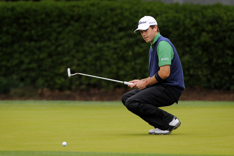 Photo - Ben Martin reacts after missing a birdie putt on the eighth green during the second round of the RBC Heritage golf tournament in Hilton Head Island, S.C., Saturday, April 19, 2014. Play was suspended during the second round Friday due to weather and resumed today.  (AP Photo/Stephen B. Morton)