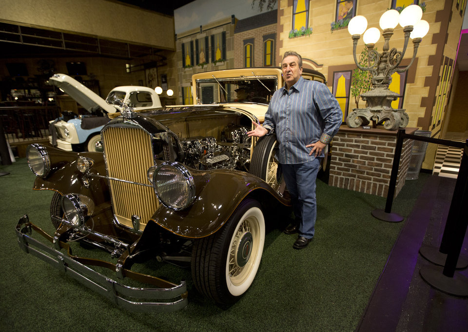 "This Monday, Nov. 26, 2012 photo shows John Staluppi as he poses by his 1929 Pierce-Arrow Custom Brougham from his private collection in North Palm Beach, Fla. John Staluppi has spent a lifetime selling cars, so successful in his trade he boasts more than two dozen dealerships and more sales than he ever could count. But even he has never seen a sale like this. Staluppi is liquidating his Cars of Dreams Museum and its 115 collector vehicles in an auction Saturday. The Batmobile, the Evel Knievel motorcycle, the lines and lines of perfectly shined cars, all of them will be gone. ""I'm starting to get sad,"" he admits. (AP Photo/J Pat Carter)"