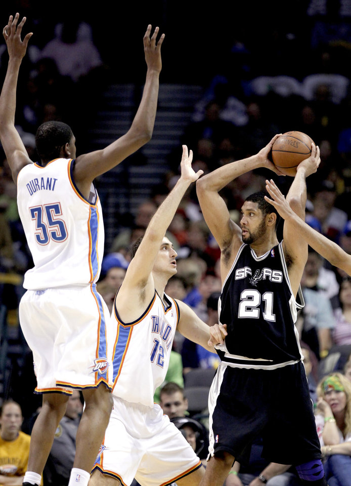 Photo - Oklahoma City's Kevin Durant (35) and Nenad Krstic (12) defend San Antonio's Tim Duncan (21) during the NBA game between Oklahoma City and San Antonio, Tuesday April 7, 2009, at the Ford Center in  Oklahoma CIty. Photo by Sarah Phipps, The Oklahoma