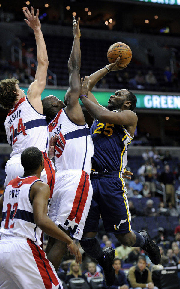 Utah Jazz's Al Jefferson (25) drives to the basket against Washington Wizards' Jan Vesely, of the Czech Republic (24), Emeka Okafor (50) and A.J. Price (12) during the first half of an NBA basketball game, Saturday, Nov. 17, 2012, in Washington. (AP Photo/Nick Wass)