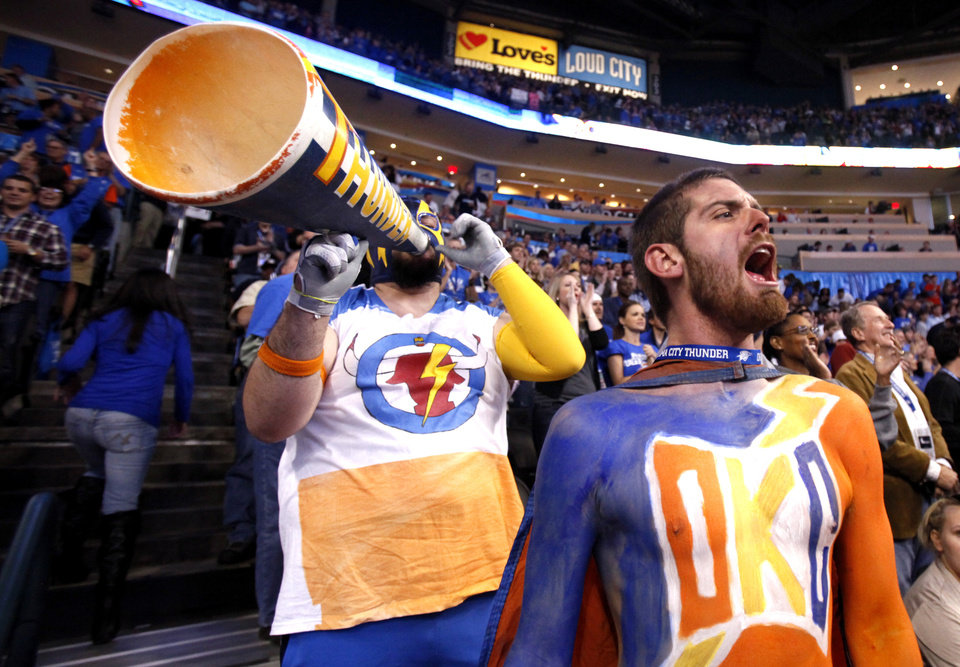 "Garrett ""Thundor"" Haviland, left, and Chris ""The Heckler"" Morris cheer during the season opener NBA basketball game between the Oklahoma City Thunder and the Chicago Bulls in the Oklahoma City Arena on Wednesday, Oct. 27, 2010. Photo by Sarah Phipps, The Oklahoman"