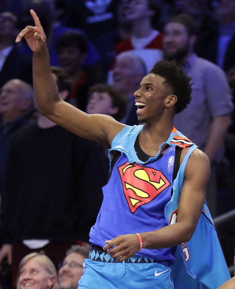 Photo - Oklahoma City Thunder Hamidou Diallo reacts to his dunk during the NBA All-Star Slam Dunk contest, Saturday, Feb. 16, 2019, in Charlotte, N.C. Diallo won the contest. (AP Photo/Chuck Burton)