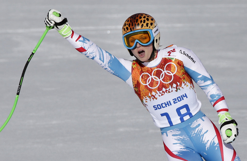 Photo - Austria's Anna Fenninger comes to a halt at the end of the women's super-G at the Sochi 2014 Winter Olympics, Saturday, Feb. 15, 2014, in Krasnaya Polyana, Russia. (AP Photo/Gero Breloer)