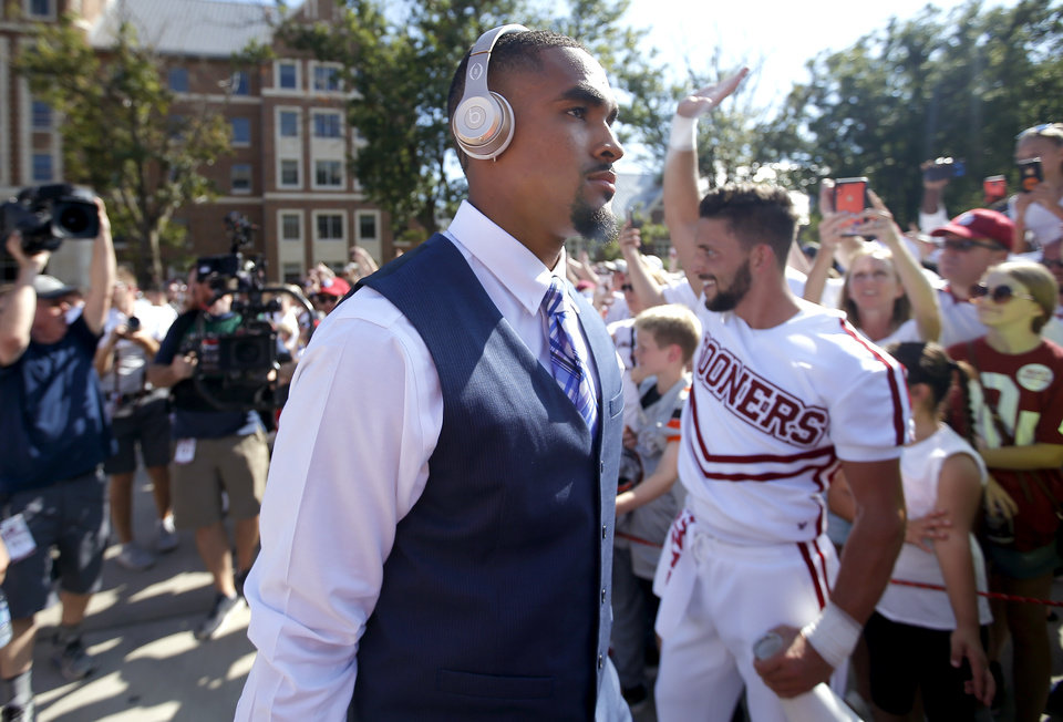 Photo - Oklahoma's Jalen Hurts (1) arrived before a college football game between the University of Oklahoma Sooners (OU) and the Houston Cougars at Gaylord Family-Oklahoma Memorial Stadium in Norman, Okla., Sunday, Sept. 1, 2019. [Sarah Phipps/The Oklahoman]