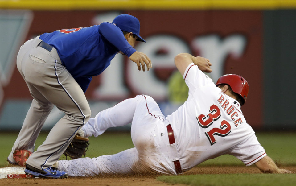 Photo - Cincinnati Reds' Jay Bruce (32) steals second base ahead of the tag by Chicago Cubs second baseman Darwin Barney in the third inning of a baseball game on Wednesday, April 30, 2014, in Cincinnati. (AP Photo)