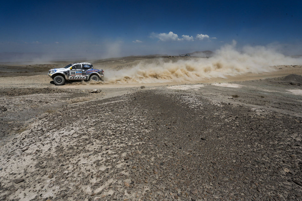 Photo - Lucio Alvarez and Bernardo Graue both of Argentina driver their Ford pick-up during the eight stage of the Dakar Rally between the cities of Salta, Argentina, and Calama, Chile, Monday, Jan. 13, 2014. (AP Photo/Victor R. Caivano)