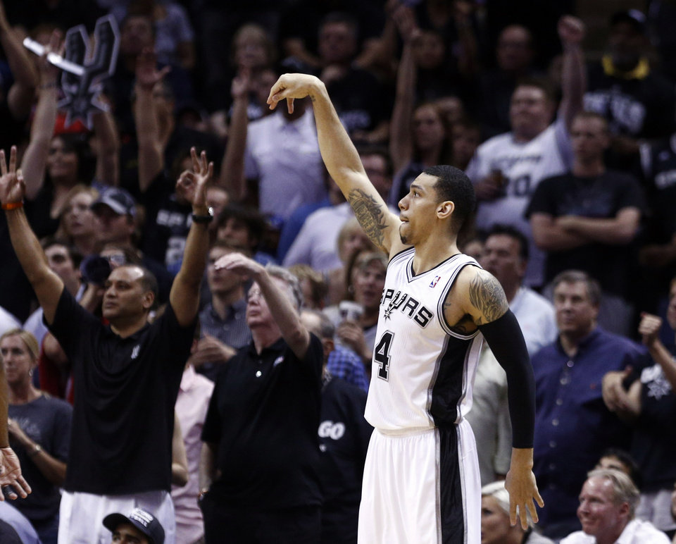 Photo - San Antonio's Danny Green (4) watches his 3-point shot go in the basket during Game 2 of the Western Conference Finals in the NBA playoffs between the Oklahoma City Thunder and the San Antonio Spurs at the AT&T Center in San Antonio, Wednesday, May 21, 2014. Photo by Sarah Phipps