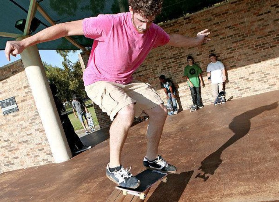 Pete Miller, of Edmond, skates during a demonstration outside the Edmond Public Library in Edmond on Monday, July 12, 2010. Photo by John Clanton, The Oklahoman ORG XMIT: KOD