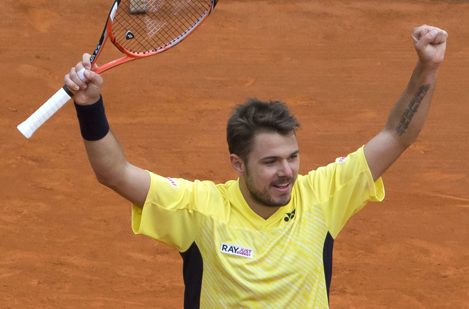 Photo - Stanislas Wawrinka of Switzerland, celebrates as he defeated David Ferrer of Spain during their semifinal match of the Monte Carlo Tennis Masters tournament in Monaco, Saturday, April 19, 2014. Wawrinka won 6-1 7-6. (AP Photo/Michel Euler)