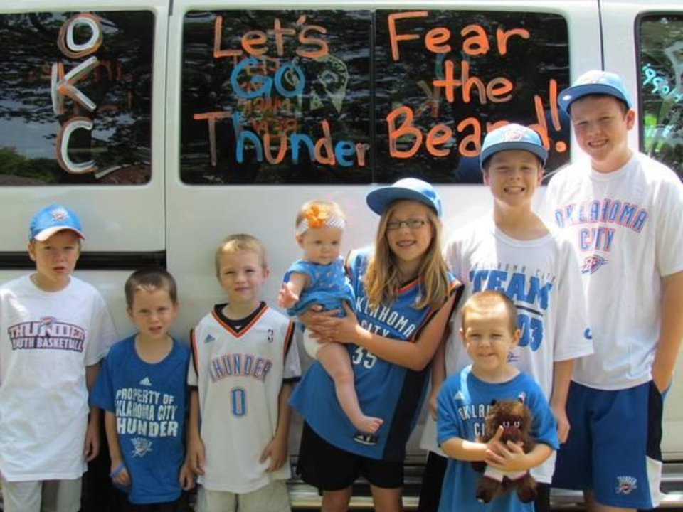 Eight Thunder fans and one sweet ride.