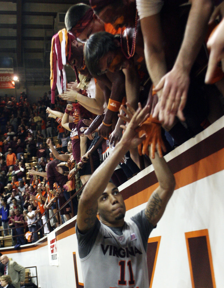 Virginia Tech guard Erick Green (11) celebrates with fans during the second half of an NCAA college basketball game against Oklahoma State in Blacksburg, Va., Saturday, Dec. 1, 2012. Green scored 28 points and hit eight critical free throws in the final 76 seconds to help Virginia Tech remain unbeaten and handed No. 10 Oklahoma State its first loss, 81-71. (AP Photo/Daniel Lin) ORG XMIT: VADL117