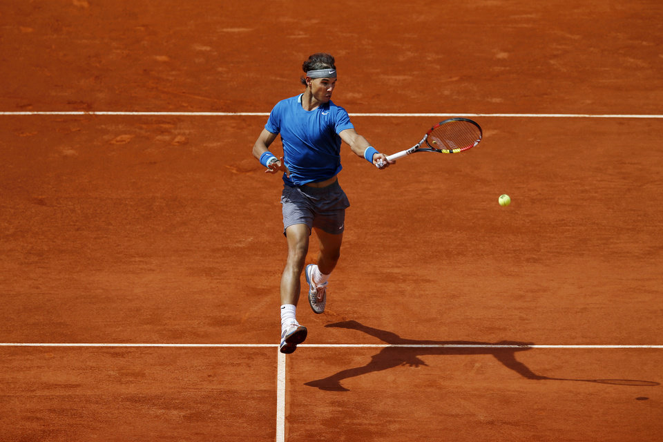 Photo - Rafael Nadal from Spain returns the ball during a Madrid Open tennis tournament match against Jarkko Nieminen, from Finland, in Madrid, Spain, Thursday, May 8, 2014 . (AP Photo/Daniel Ochoa de Olza)