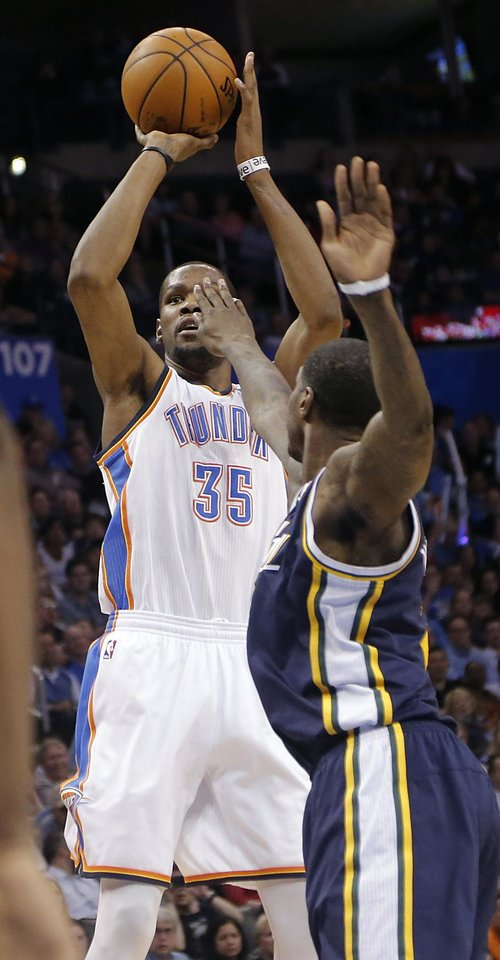Photo - Oklahoma City Thunder's Kevin Durant (35) shoots over Utah Jazz's Marvin Williams (2) during the NBA basketball game between the Oklahoma City Thunder and the Utah Jazz at Chesapeake Energy Arena on Wednesday, March 13, 2013, in Oklahoma City, Okla. Photo by Chris Landsberger, The Oklahoman