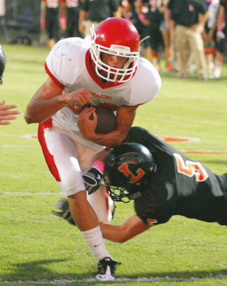 Photo - Purcell quarterback Cole Swayze (23) scores in the first quarter through a tackle attept by Lexington's Kyle Forehand (5) in high school football on Friday, Sept. 17, 2010, in Lexington, Okla.   Photo by Steve Sisney, The Oklahoman ORG XMIT: KOD