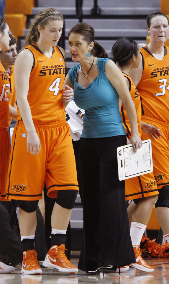 OSU assistant coach Miranda Serna talks with a player during a timeout during an exhibition women's NCAA college basketball game between the Oklahoma State University Cowgirls and the Fort Hays State Tigers at Gallagher-Iba Arena in Stillwater, Okla., Wednesday, Nov. 9, 2011. Photo by Bryan Terry, The Oklahoman