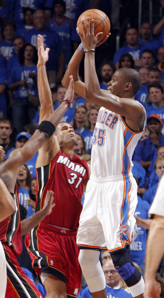 Oklahoma City's Kevin Durant (35) puts up a shot over Miami's Shane Battier (31) during Game 1 of the NBA Finals between the Oklahoma City Thunder and the Miami Heat at Chesapeake Energy Arena in Oklahoma City, Tuesday, June 12, 2012. Photo by Chris Landsberger, The Oklahoman