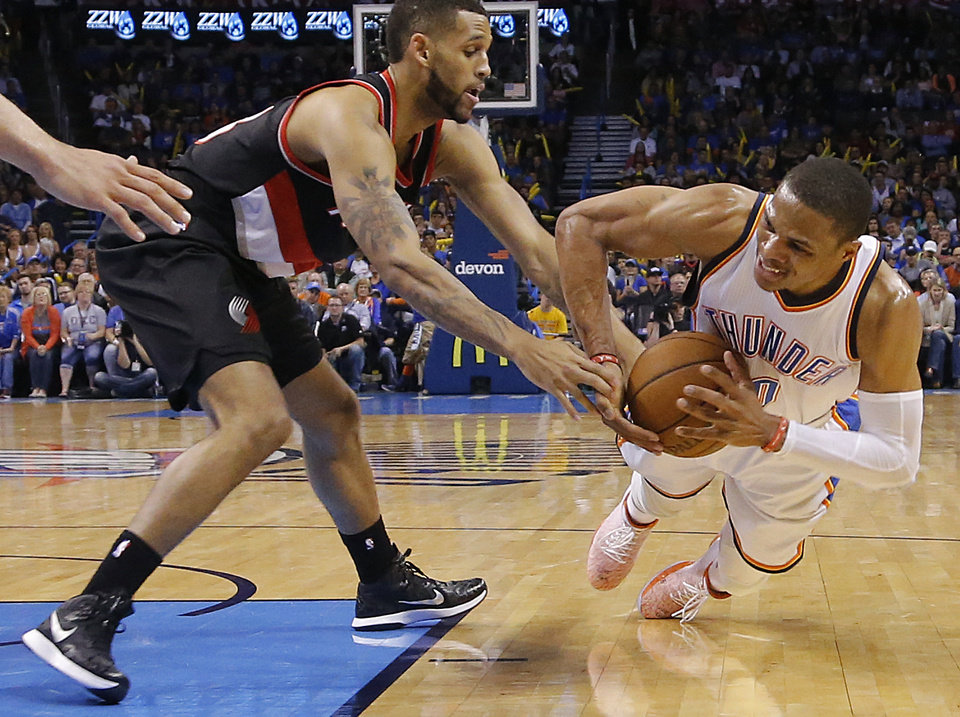 Photo - Oklahoma City's Russell Westbrook (0) goes for a loose ball against Portland's Allen Crabbe (23) during the NBA basketball game between the Oklahoma City Thunder and the Portland Trailblazers at Chesapeake Energy Arena  in Oklahoma City, Okla. on Monday, April 13, 2015. Photo by Chris Landsberger, The Oklahoman