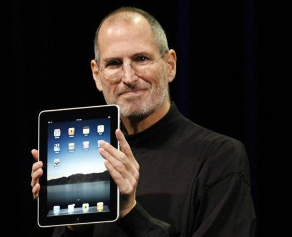 Apple CEO Steve Jobs shows off the new iPad during an event in San Francisco, Wednesday, Jan. 27, 2010. (AP Photo/Paul Sakuma)