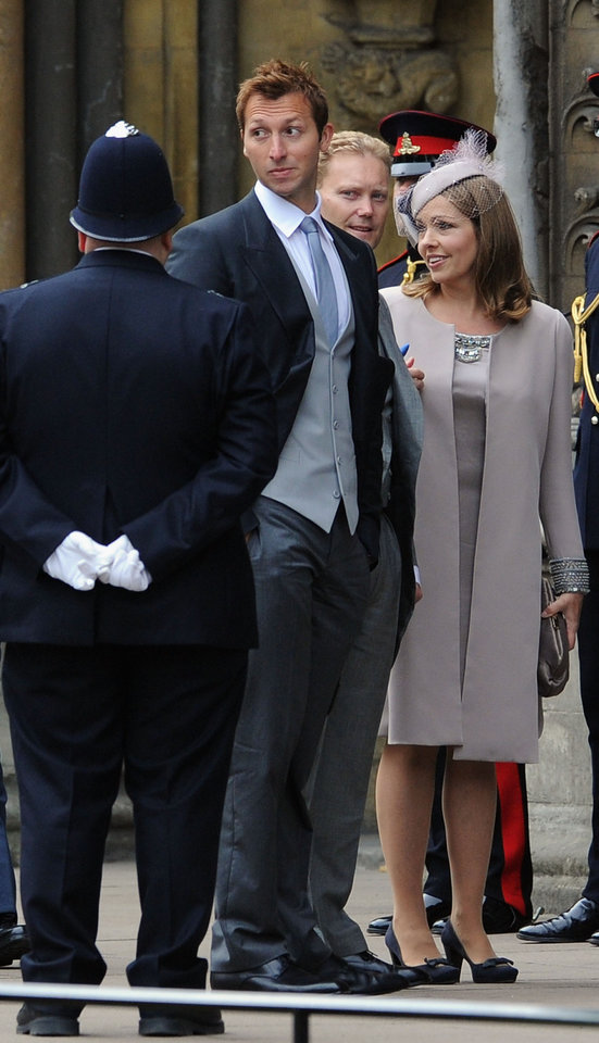Photo - Australian Olympian swimmer Ian Thorpe, second left, arrives at Westminster Abbey in London where Britain's Prince William and Kate Middleton will marry, Friday April 29, 2011. (AP Photo/Jasper Juinen, Pool) ORG XMIT: RWBJ109
