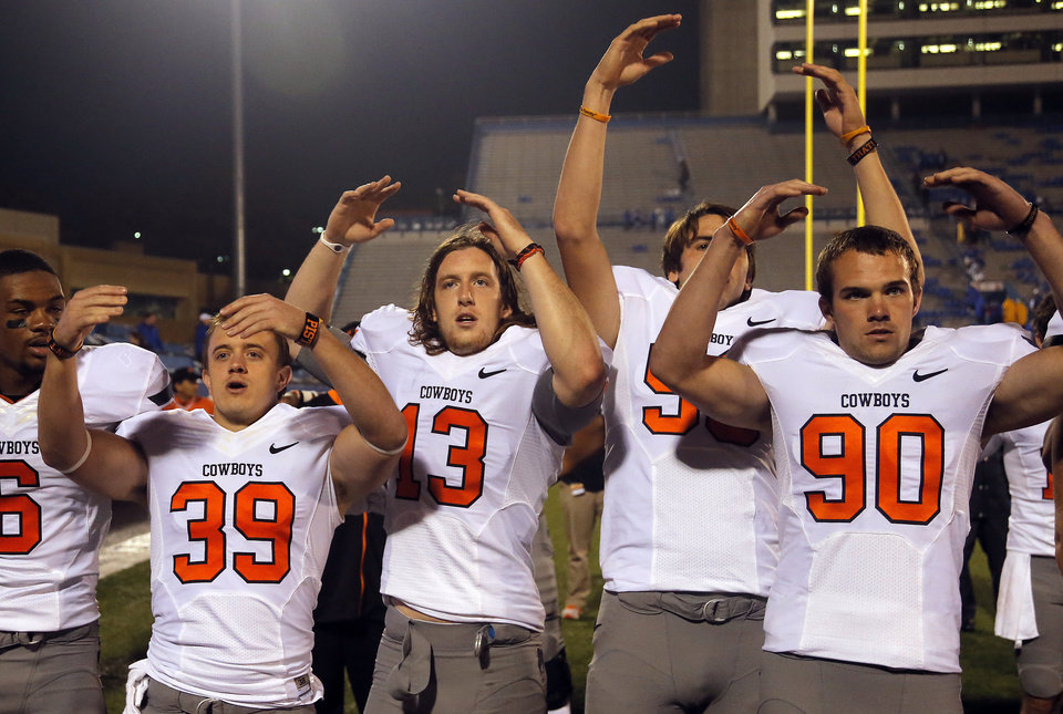 Oklahoma State's Quinn Sharp (13) sings following the college football game between Oklahoma State University (OSU) and the University of Kansas (KU) at Memorial Stadium in Lawrence, Kan., Saturday, Oct. 13, 2012. Photo by Sarah Phipps, The Oklahoman