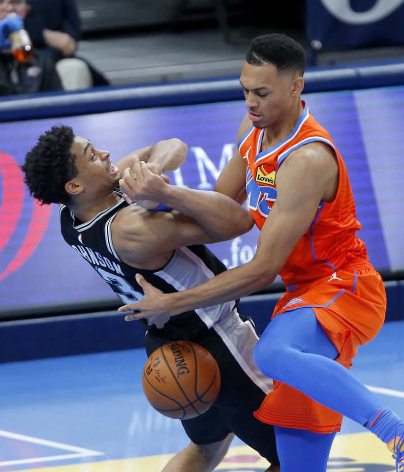 Photo - Oklahoma City's Darius Bazley (7) tries to get the ball beside San Antonio's Keldon Johnson (3) during an NBA basketball game between the Oklahoma City Thunder and the San Antonio Spurs at Chesapeake Energy Arena in Oklahoma City, Tuesday, Jan. 12, 2021.  San Antonio won 112-102. [Bryan Terry/The Oklahoman]