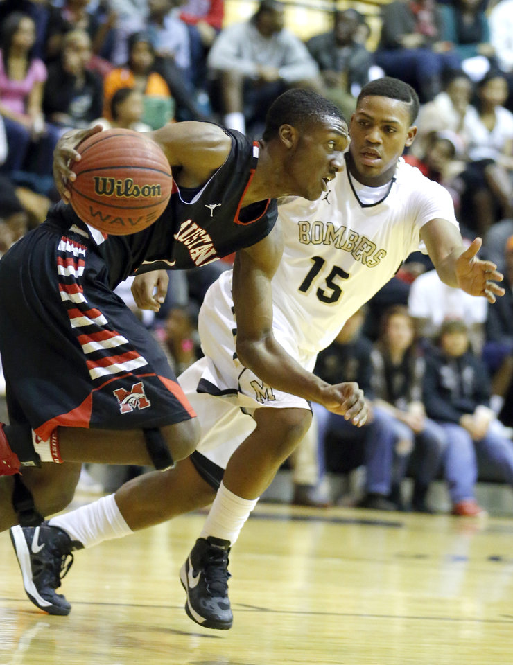 HIGH SCHOOL BASKETBALL TOURNAMENT: Mustang's Jakolby Long tries to get by Midwest City's Cornell Neal during the boys basketball game between Mustang and Midwest City at the Midwest City/Del City Holiday Invitational,  Saturday,Dec. 29, 2012. Photo by Sarah Phipps, The Oklahoman