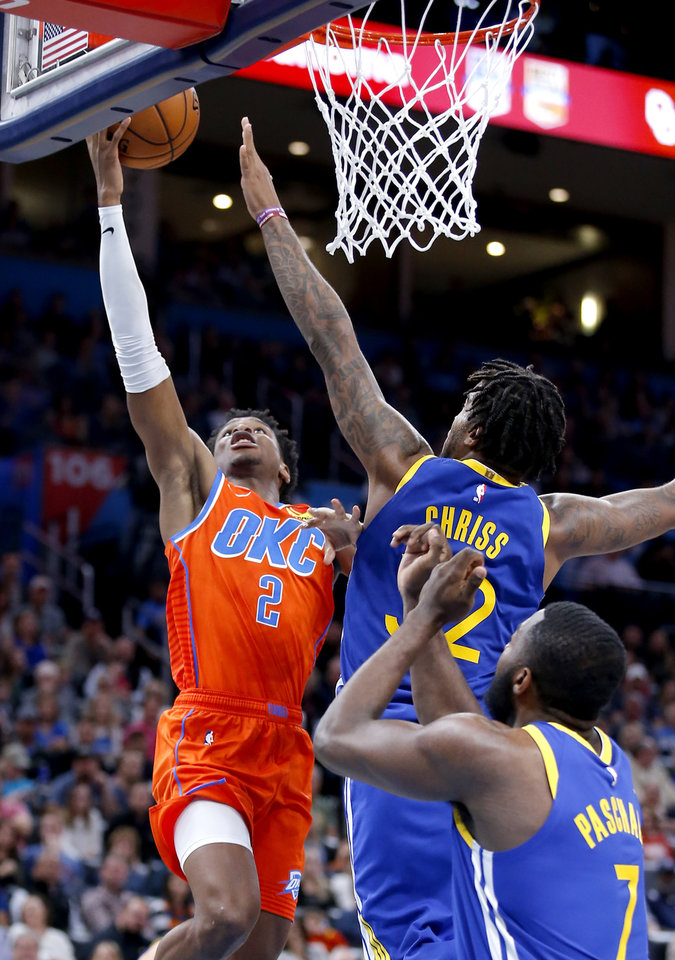 Photo - Oklahoma City's Shai Gilgeous-Alexander (2) goes up for a basket as Golden State's Marquese Chriss (32) and Eric Paschall (7) defend during the NBA game between the Oklahoma City Thunder and Golden State Warriors at Chesapeake Energy Arena,  Sunday, Oct. 27, 2019. [Sarah Phipps/The Oklahoman]