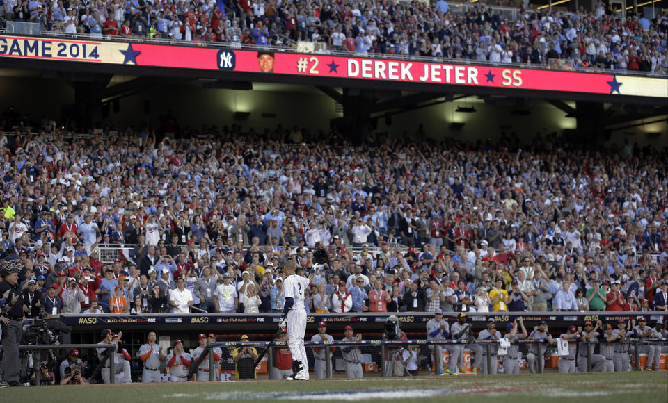 Photo - American League shortstop Derek Jeter, of the New York Yankees, steps to the plate during the first inning of the MLB All-Star baseball game, Tuesday, July 15, 2014, in Minneapolis. (AP Photo/Jeff Roberson)