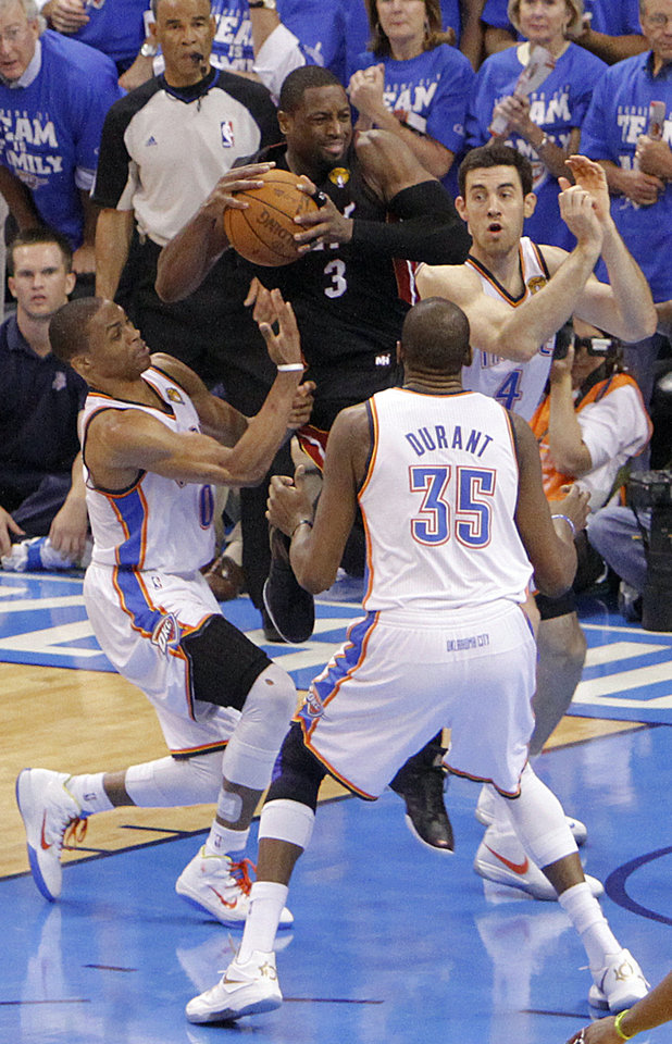 Photo - Oklahoma City's Russell Westbrook (0), Oklahoma City's Kevin Durant (35) and Oklahoma City's Nick Collison (4) defend on Miami's Dwyane Wade (3)  during Game 2 of the NBA Finals between the Oklahoma City Thunder and the Miami Heat at Chesapeake Energy Arena in Oklahoma City, Thursday, June 14, 2012. Photo by Chris Landsberger, The Oklahoman