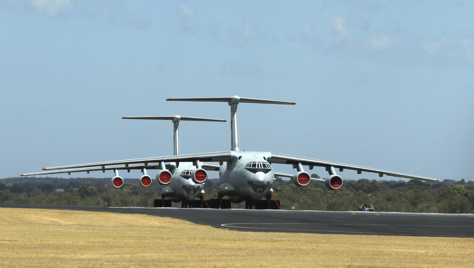 Photo - Two Chinese  Ilyushin IL-76s aircraft sit on the tarmac at RAAF Pearce base ready to join the search for the missing Malaysia Airlines flight MH370 in Perth, Australia, Sunday, March 23, 2014. More planes were joining the search Sunday of a remote patch of the southern Indian Ocean in hopes of finding answers to the fate of the missing Malaysia Airlines jet, after China released a satellite image showing a large object floating in the search zone.(AP Photo/Rob Griffith)