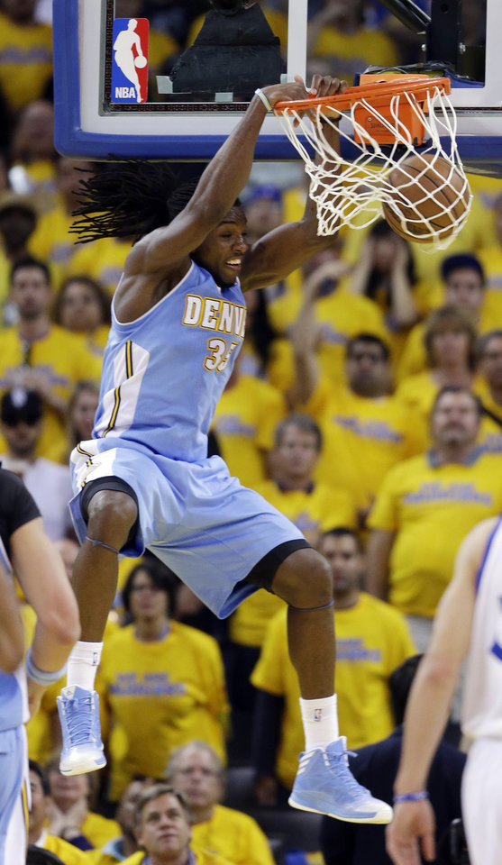 Denver Nuggets' Kenneth Faried dunks against the Golden State Warriors during the first half of Game 6 in a first-round NBA basketball playoff series in Oakland, Calif., Thursday, May 2, 2013. (AP Photo/Marcio Jose Sanchez)