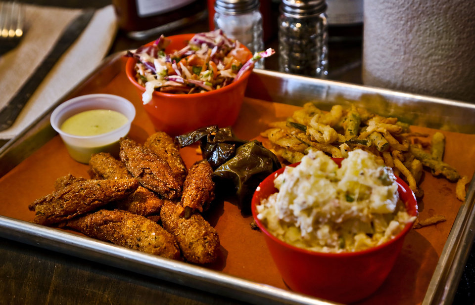 Photo - A selection of side items that can be ordered with a meal at the new Back Door Barbecue at 315 NW 23 in Oklahoma City. Photo by Chris Landsberger, The Oklahoman  CHRIS LANDSBERGER - CHRIS LANDSBERGER