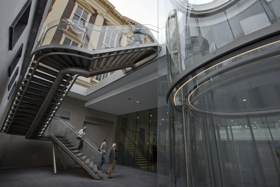 Photo - Visitors walk down the stairs of the renovated Mauritshuis museum during a preview for the press in The Hague, Netherlands, Friday, June 20, 2014. The Mauritshuis reopens after a two-year renovation that allowed its masterpieces, including Vermeer's The Girl with the Pearl Earring to be seen by record-setting crowds abroad. The public will have access for free from 8 pm till midnight on Friday June 27th after the official ceremonial opening and from June 28 onwards the museum will revert to regular opening hours. (AP Photo/Peter Dejong)
